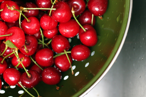 Tart cherries in a green bowl